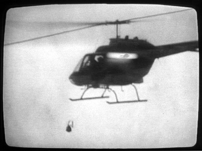 Helicopter dropping bomb on MOVE